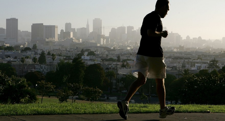 SAN FRANCISCO - JULY 13:  With the San Francisco skline in the background, a jogger runs through Dolores Park July 13, 2005 in San Francisco. Runner's World Magazine has just named San Francisco the best city for running in the United States based on its weather, the number of running clubs, racing events and the the ample park space available for runners.  (Photo by Justin Sullivan/Getty Images)